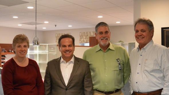 Pictured left to right: Sharon Wood, CFO Minuteman Trucks, Congressman David Cicilline, Bill Witcher, COO Minuteman Trucks, and Dick Witcher, CEO Minuteman Trucks.