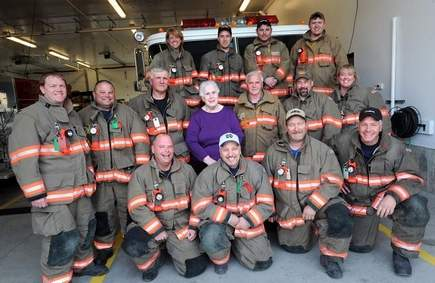 Members of the West Rutland Fire Department with Martha Alexander, who recently donated $500,000 that the department used to replace one of their current fire engines.